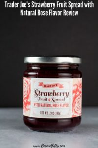 An unopened jar of Trader Joe's Strawberry Fruit Spread with Natural Rose Flavor image for Pinterest