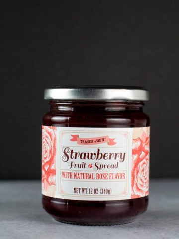 An unopened jar of Trader Joe's Strawberry Fruit Spread with Natural Rose Flavor