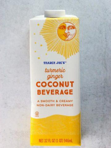 An unopened box of Trader Joe's Tumeric Ginger Coconut Beverage