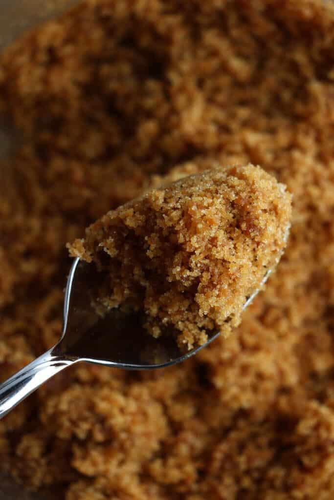 homemade dark brown sugar on a spoon