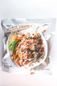 An unopened bag of Trader Joe's Chicken Chilaquiles Rojo