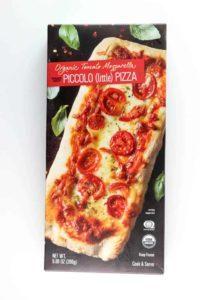 An unopened box of Trader Joe's Organic Tomato Mozzarella Piccolo Pizza