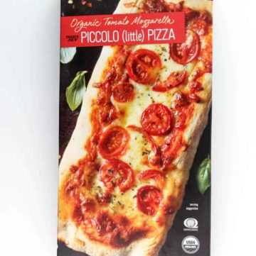 An unopened box of Trader Joe's Organic Tomato Mozzarella Piccolo Pizza