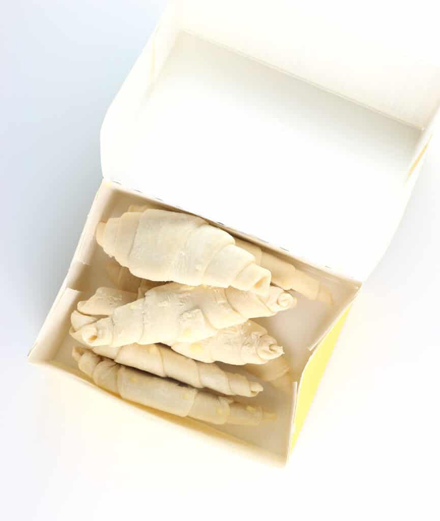 An open box of Trader Joe's 8 Mini Croissants showing the frozen uncooked pastries