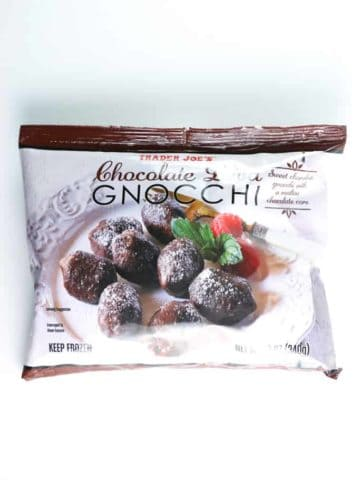 A unopened bag of Trader Joe's Chocolate Lava Gnocchi on a white sufrace