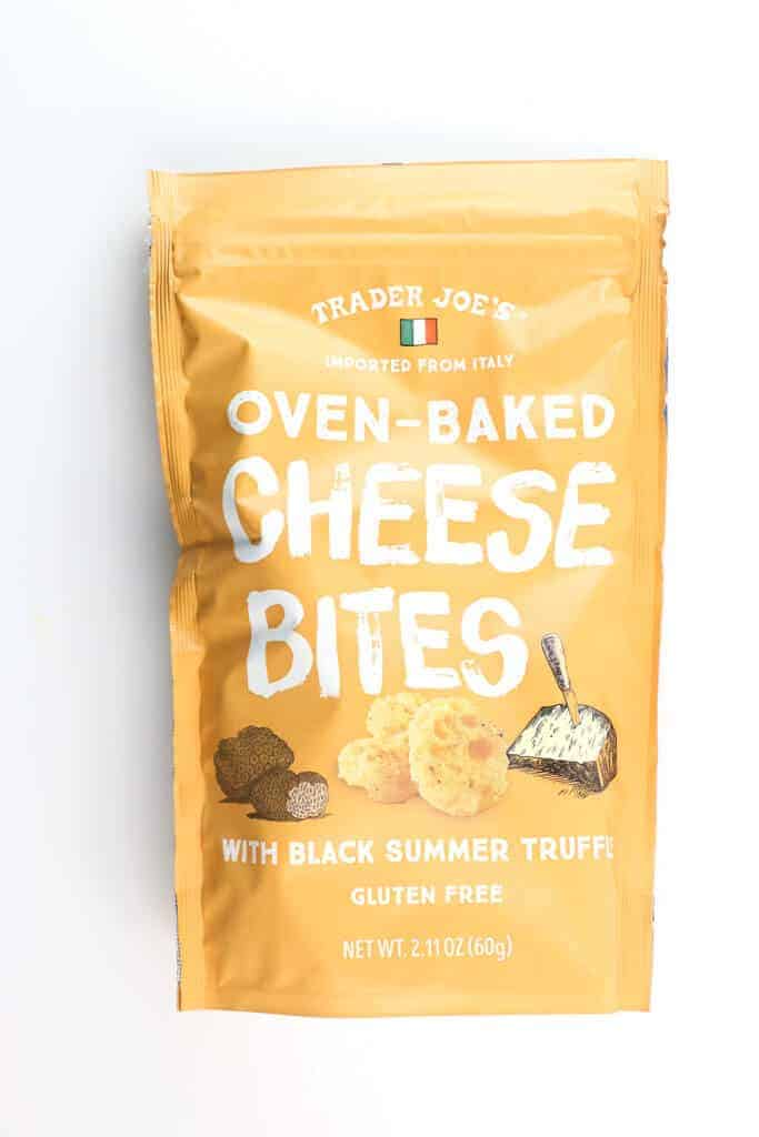 An unopened bag of Trader Joe's Oven Baked Cheese Bites with Black Truffle