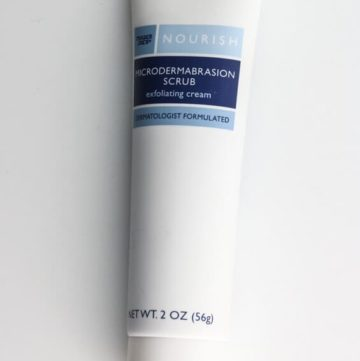 An unopened package of rader Joe's Microdermabrasion Scrub on a white surface