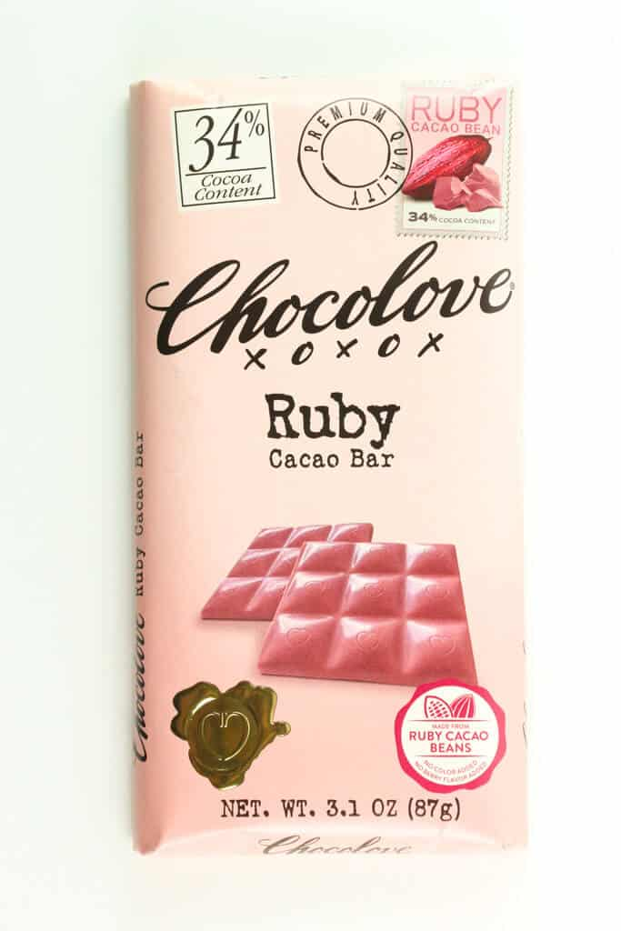 An unopened Chocolove xoxox Ruby Cacao Bar