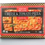 An unopened box of Trader Joe's Organic Cheese and Tomato Family Size Pizza