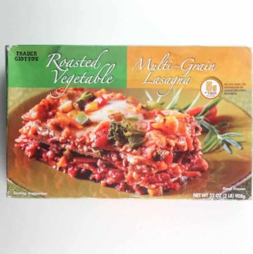 An unopened box of Trader Joe's Roasted Vegetable Multi-Grain Lasagna