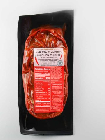 An unopened package of Trader Joe's Harissa Flavored Chicken Thighs