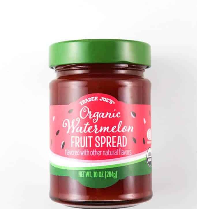 An unopened jar of Trader Joe's Organic Watermelon Fruit Spread on a white surface