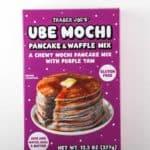 An unopened box of Trader Joe's Ube Mochi Pancake Mix on a light surface