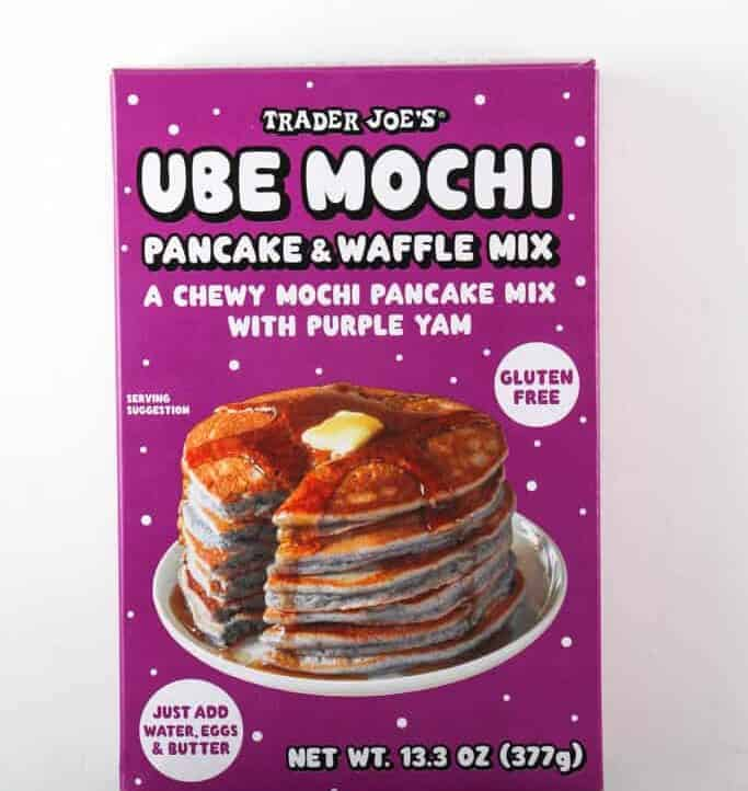 An unopened box of Trader Joe's Ube Mochi Pancake Mix on a light surface