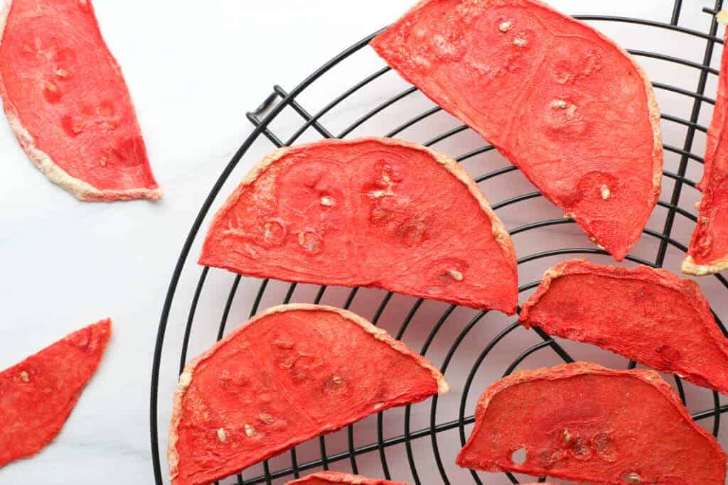 Fully dehydrated watermelon slices on a wire rack