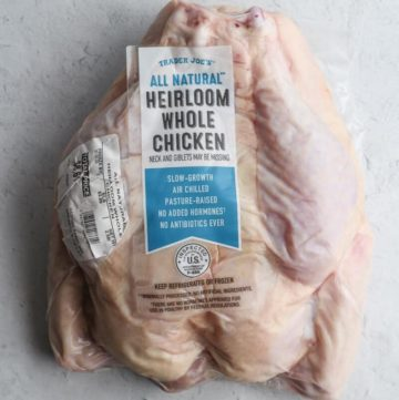 An unopened package of Trader Joe's All Natural Heirloom Whole Chicken