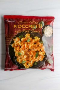 An unopened bag of Trader Joe's Cheese Filled Fiocchetti with Pink Sauce