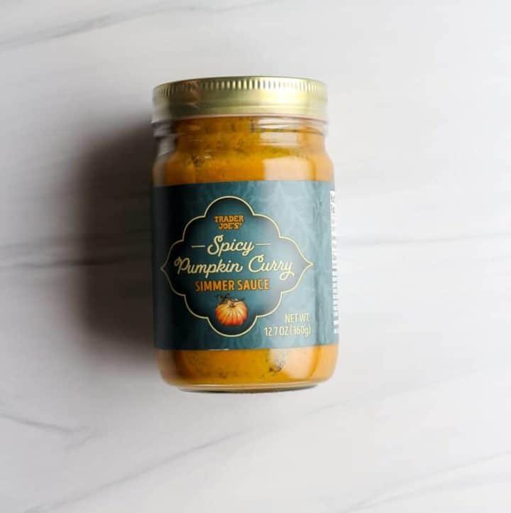 An unopened jar of Trader Joe's Spicy Pumpkin Curry