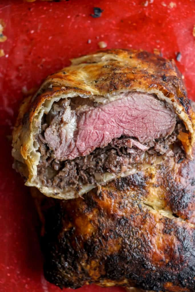 A Trader Joe's Beef en Croute cut in the middle revealing the light pink center.