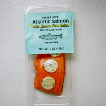 An unopened package of Trader Joe's Atlantic Salmon with Lemon Herb Butter
