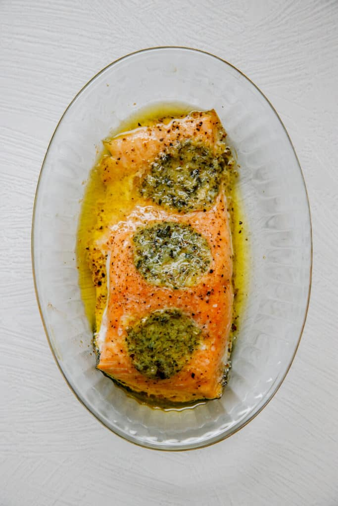 A fully cooked Trader Joe's Atlantic Salmon with Lemon Herb Butter in a glass dish