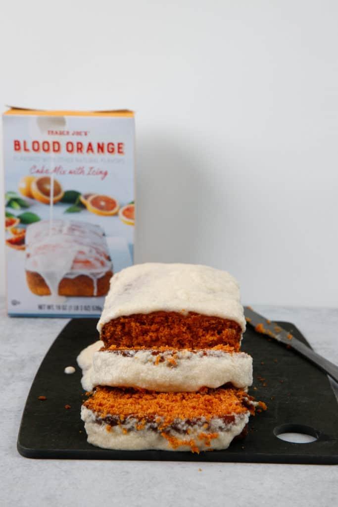 A sliced Trader Joe's Blood Orange Cake so you can see the bright orange inside