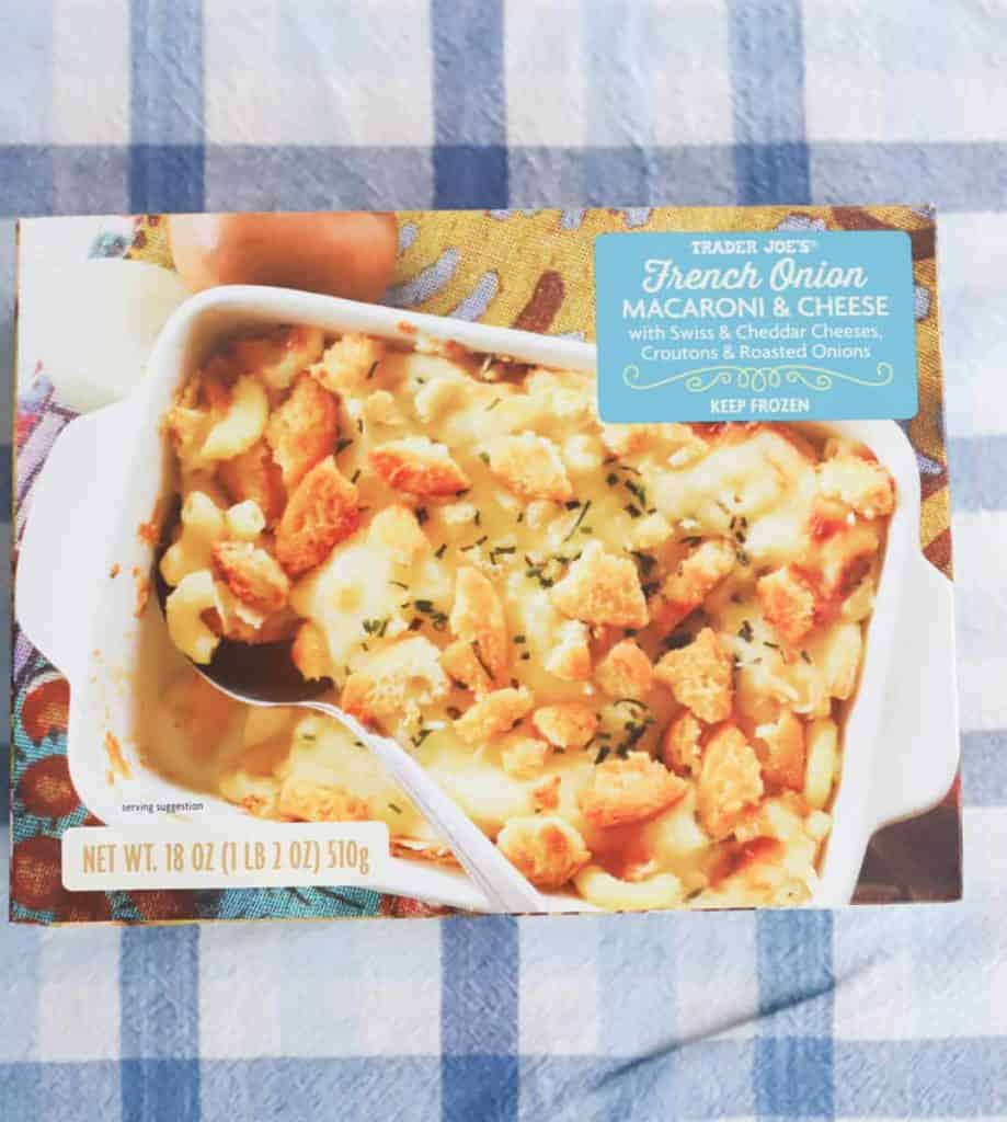 Trader Joe's French Onion Mac and Cheese unopened box on a plaid tablecloth
