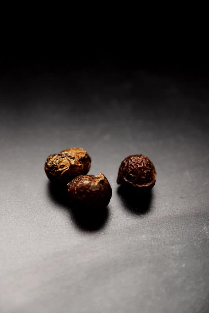 Three of Trader Joe's Laundry Soap Nuts out of the bag