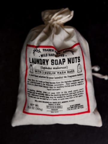 An unopened bag of Trader Joe's Laundry Soap Nuts on a dark surface
