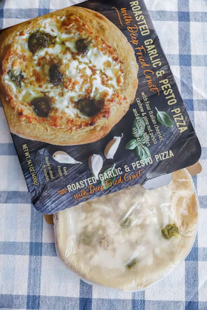 Trader Joe's Roasted Garlic and Pesto Pizza out of the box but still frozen
