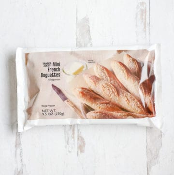 An unopened bag of Trader Joe's Mini French Baguettes