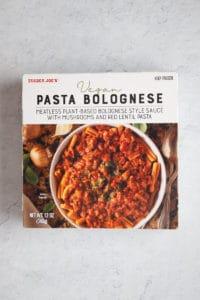 Trader Joe's Vegan Pasta Bolognese box unopened on a grey surface