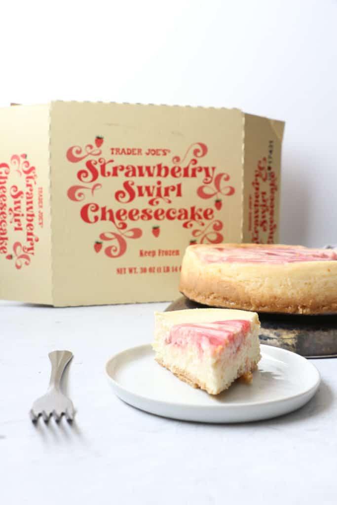 A slice of the strawberry swirl wcheesecake