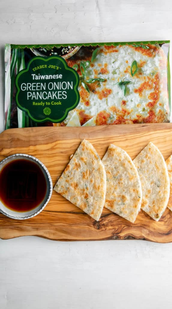 Fully cooked and quartered Trader Joe's Taiwanese Green Onion Pancakes with a soy dipping sauce