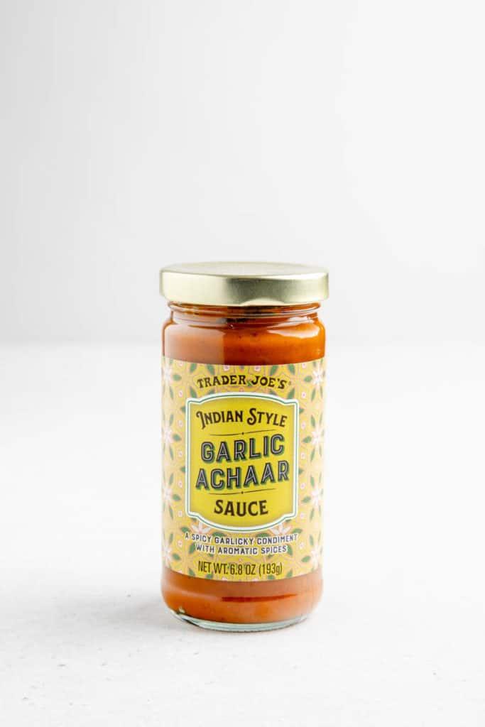 An unopened jar of Trader Joe's Garlic Achaar Sauce