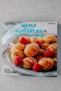 Trader Joe's Maple Poffertjes Mini Pancakes unopened on a grey surface